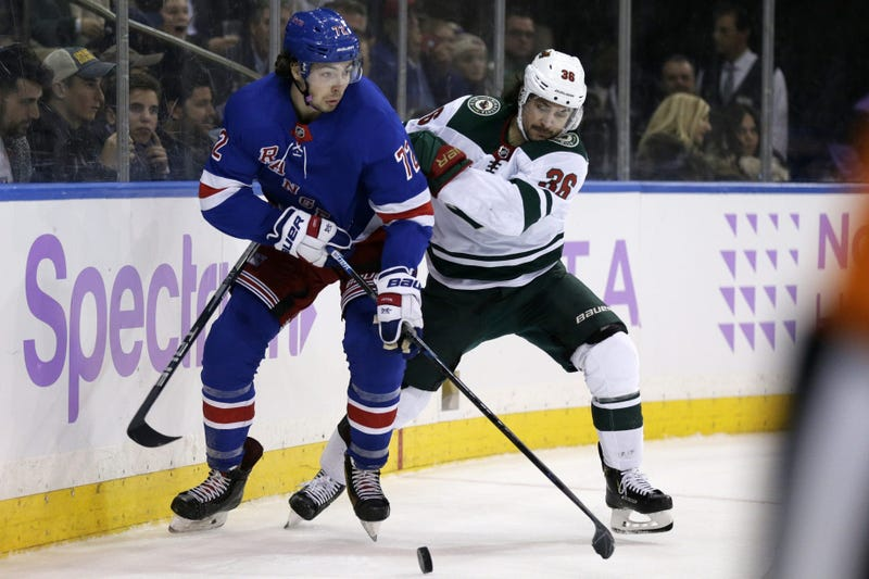 Mats Zuccarello and Filip Chytil and the puck