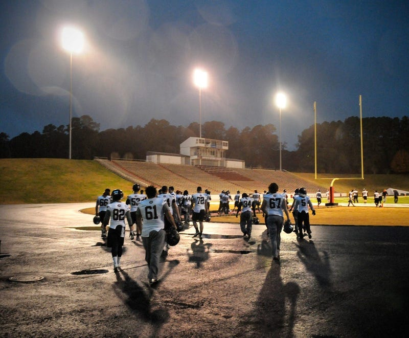 St. Cloud State players take the field in a light rain to practice Friday, Nov. 22, 2013,