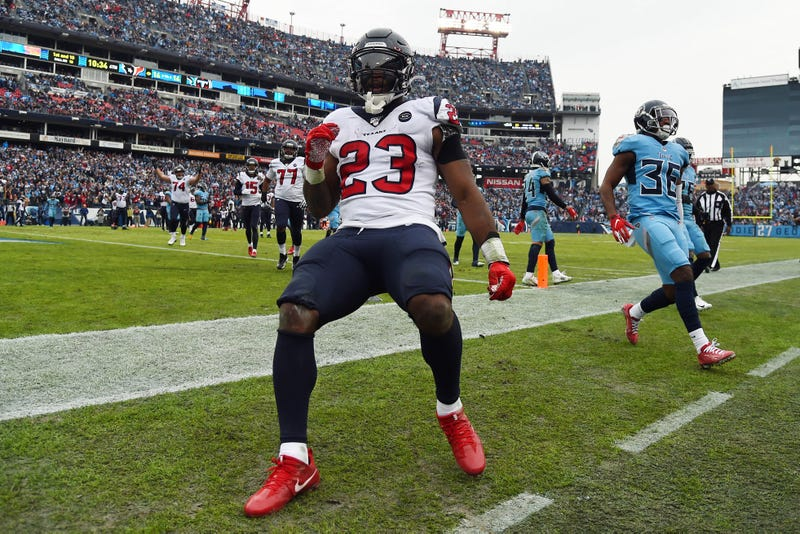 Houston Texans running back Carlos Hyde (23) runs for a touchdown during the second half against the Tennessee Titans at Nissan Stadium.