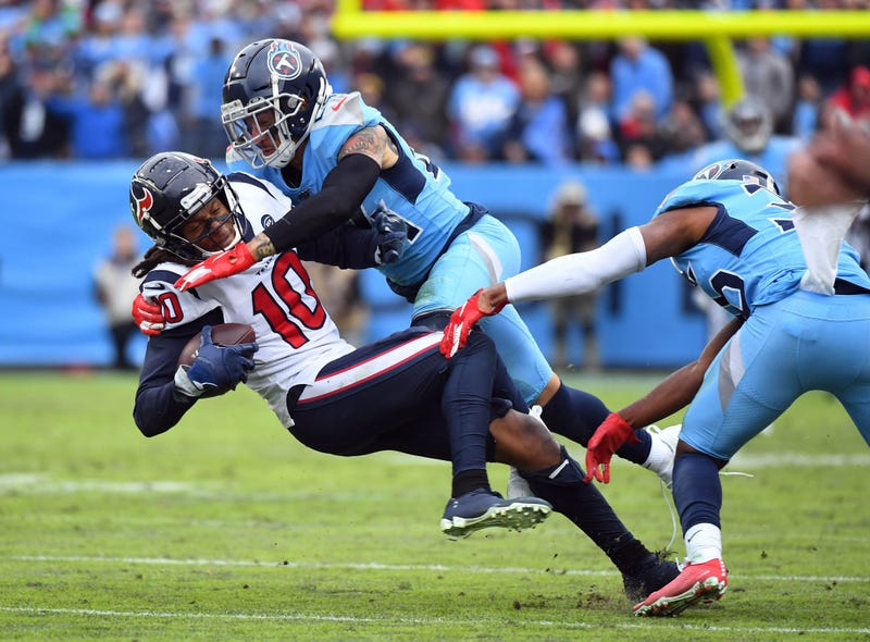 Houston Texans wide receiver DeAndre Hopkins (10) is tackled by Tennessee Titans strong safety Kenny Vaccaro (24) after a catch during the second half at Nissan Stadium.