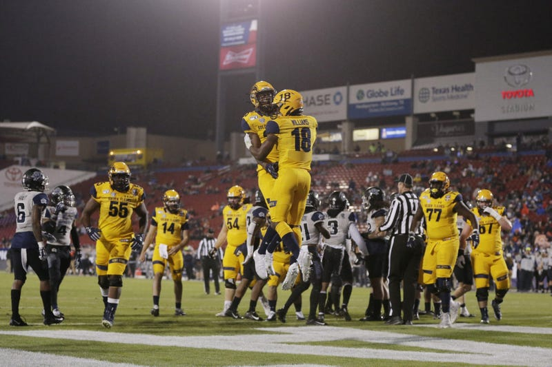 Kent State Golden Flashes running back Xavier Williams (18) and wide receiver Isaiah McKoy (23) celebrate a toouchdown in the first quarter against the Utah State Aggies during the Frisco Bowl at Toyota Stadium.