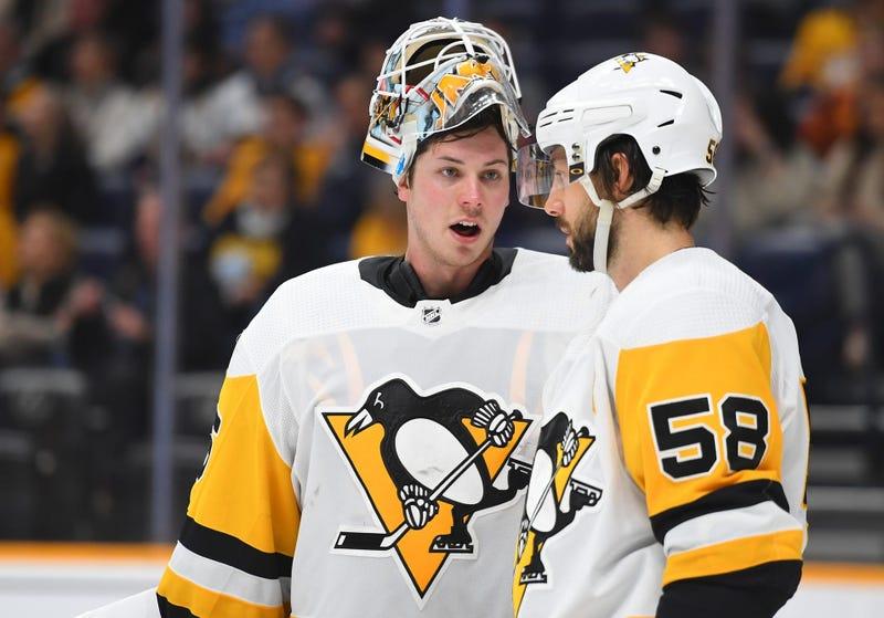 ittsburgh Penguins goaltender Tristan Jarry (35) talks with Pittsburgh Penguins defenseman Kris Letang