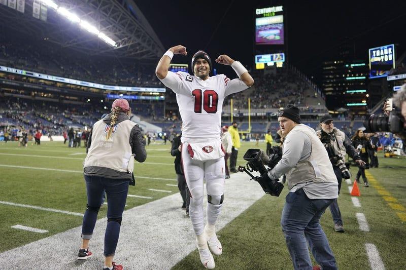 Jimmy Garoppolo celebrates 49ers' NFC West clinching win