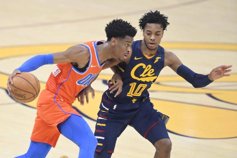 Jan 4, 2020; Cleveland, Ohio, USA; Oklahoma City Thunder guard Shai Gilgeous-Alexander (2) drives against Cleveland Cavaliers guard Darius Garland (10) in the first quarter at Rocket Mortgage FieldHouse. Mandatory Credit: David Richard-USA TODAY Sports