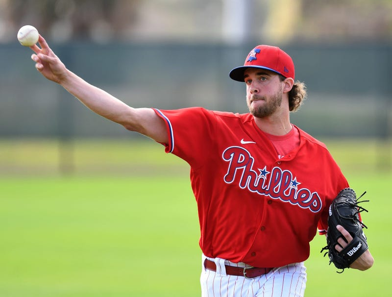 Philadelphia Phillies pitcher Aaron Nola (27) throws during Wednesday's spring training workout at Spectrum Field.
