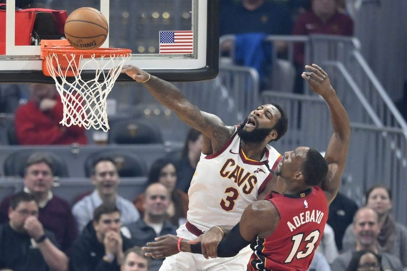 Feb 24, 2020; Cleveland, Ohio, USA; Cleveland Cavaliers center Andre Drummond (3) misses a dunk beside Miami Heat forward Bam Adebayo (13) in the first quarter at Rocket Mortgage FieldHouse. Mandatory Credit: David Richard-USA TODAY Sports
