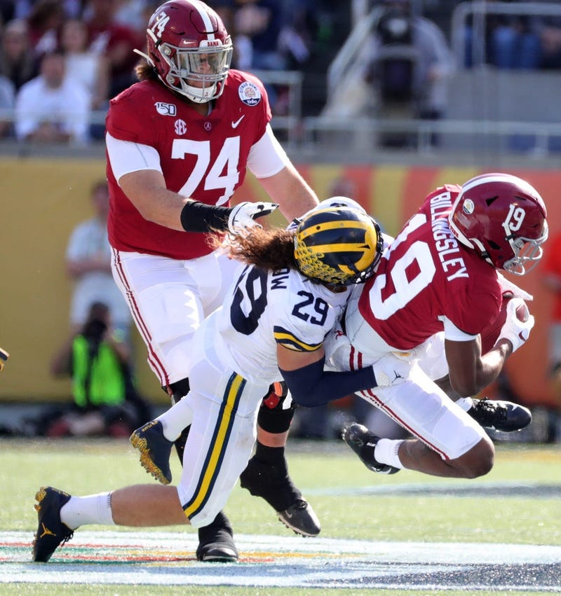Alabama's Jedrick Wills Jr. (74) watches as Michigan's Jordan Glasgow tackles Alabama's Jahleel Billingsley during the Citrus Bowl, Jan. 1, 2020 in Orlando, Fla.