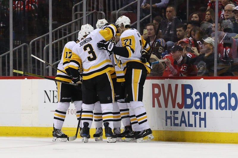 The Pittsburgh Penguins celebrate after a goal by defenseman Justin Schultz (4) against the New Jersey Devils during the second period at Prudential Center.