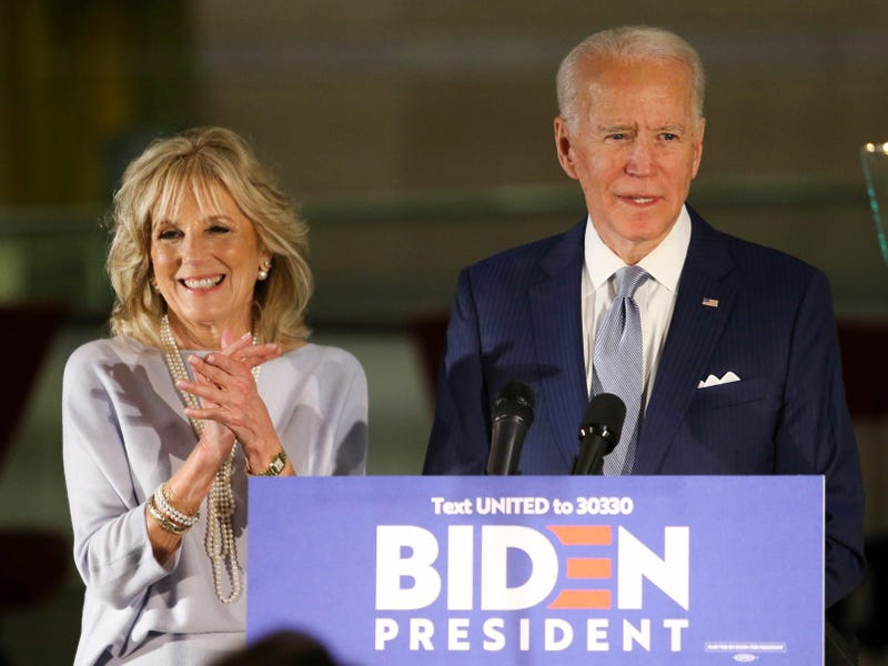 Joe Biden, with Jill Biden at his side, gives remarks at the National Constitution Center in Philadelphia after his 'Big Tuesday' primary election night campaign event in Ohio was cancelled due to coronavirus concerns.