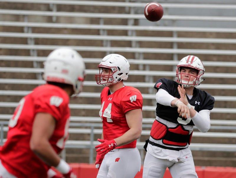Wisconsin Badgers quarterback Graham Mertz (5) finds an open receiver