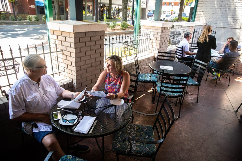 Vickie and Jeff Fuller, of Greenville, celebrate Jeff Fuller's 65th birthday at Pomegranate on Main Monday, May 4, 2020, the first day that restaurants downtown began to reopen outdoor seating since Gov. Henry McMaster banned on-premises dining in March
