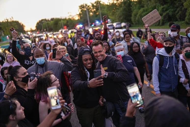 Chris Swanson, Genesee County Sheriff, Police, Selfie, March, Protest, Crowd
