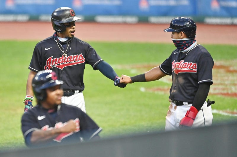 Cleveland Indians shortstop Francisco Lindor (12) celebrates with second baseman Cesar Hernandez (7) after hitting a three-run home run during the fifth inning against the Pittsburgh Pirates at Progressive Field.