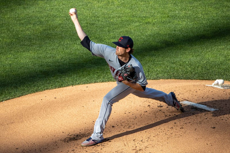 Jul 30, 2020; Minneapolis, Minnesota, USA; Cleveland Indians starting pitcher Shane Bieber (57) delivers a pitch against the Minnesota Twins in the first inning at Target Field. Mandatory Credit: Jesse Johnson-USA TODAY Sports