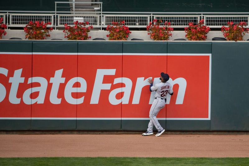 Cleveland Indians left fielder Daniel Johnson (23) looks on at Minnesota Twins left fielder Eddie Rosario (20) (not picutred) solo home run during the fourth inning at Target Field