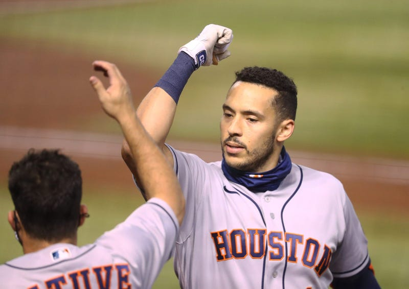 Houston Astros shortstop Carlos Correa celebrates with teammate Jose Altuve after hitting a solo home run in the second inning against the Arizona Diamondbacks at Chase Field.