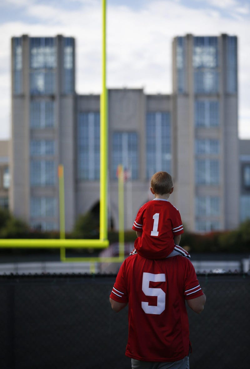 Ohio State fan Owen Nelms, 3, of Indianapolis, sits atop his dad, Brandon, before a NCAA Division I football game between the Indiana Hoosiers and the Ohio State Buckeyes on Saturday, September 14, 2019 at Memorial Stadium in Bloomington, Indiana.