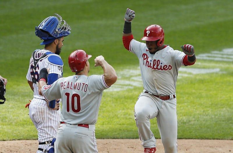 Philadelphia Phillies second baseman Jean Segura (2) reacts with Philadelphia Phillies catcher J.T. Realmuto (10) after hitting the game-winning two-run home run as New York Mets catcher Robinson Chirinos (26) looks away.