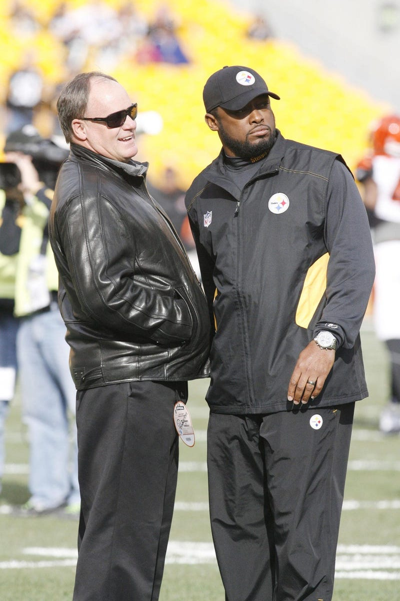Kevin Colbert and Mike Tomlin on field