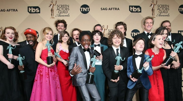 Jan 29, 2017; Los Angeles, CA, USA; The cast of Stranger Things pose with their awards for Outstanding Ensemble in a Drama Series for 'Stranger Things' in the photo room at the 23rd Annual Screen Actors Guild Awards at the Shrine Auditorium