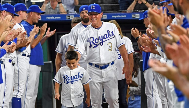 Kansas City Royals manager Ned Yost (3) walks out onto the field with his family before being honored, prior to a game against the Minnesota Twins at Kauffman Stadium.