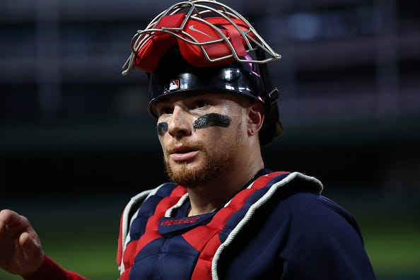 Christian Vazquez glances back to the Red Sox dugout.