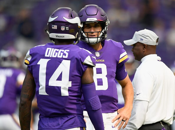 Vikings QB Kirk Cousins chats with former wide receiver Stefon Diggs.