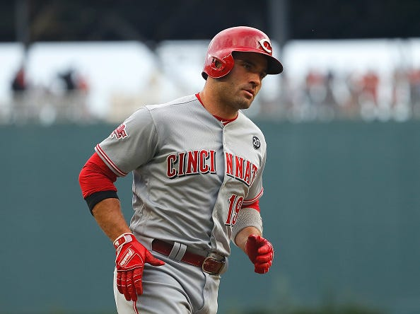 Reds slugger Joey Votto rounds the bases after hitting a home run.