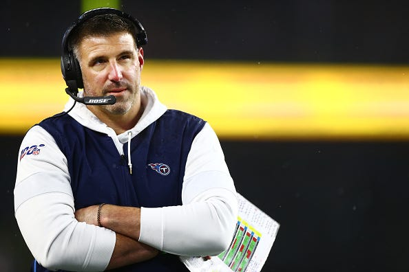 Titans head coach Mike Vrabel looks on during a playoff game.