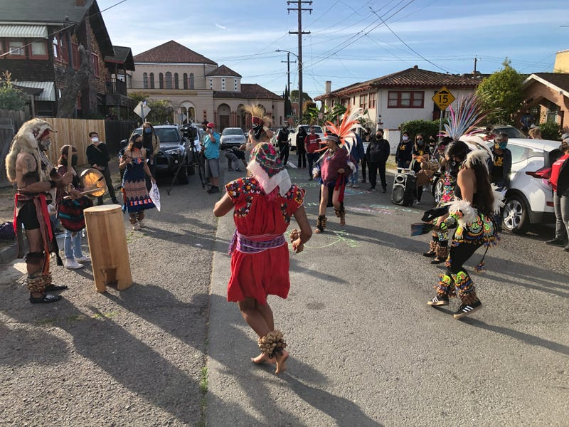 """Aztec dancers, drummers delivered a """"wake up"""" call to Oakland city leaders calling on them to defund the city's police department"""