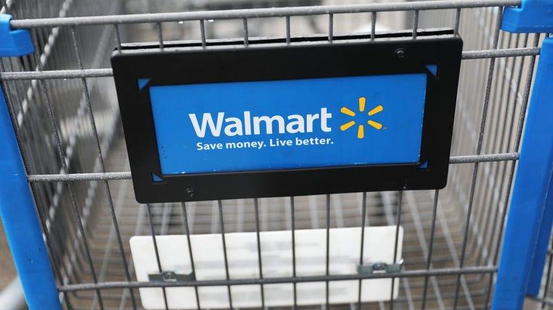 a walmart sign on a shopping cart