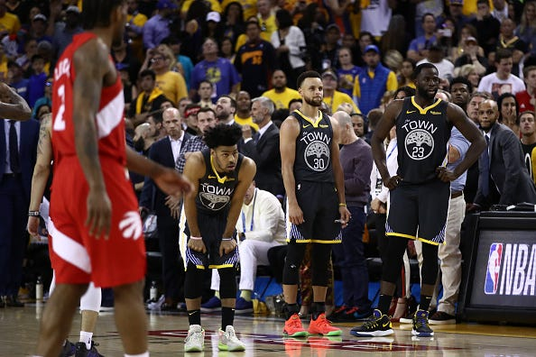 Warriors players look on at the end of Game of the 2019 NBA Finals.
