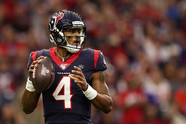 Texans QB Deshaun Watson eyes his receivers during a game.