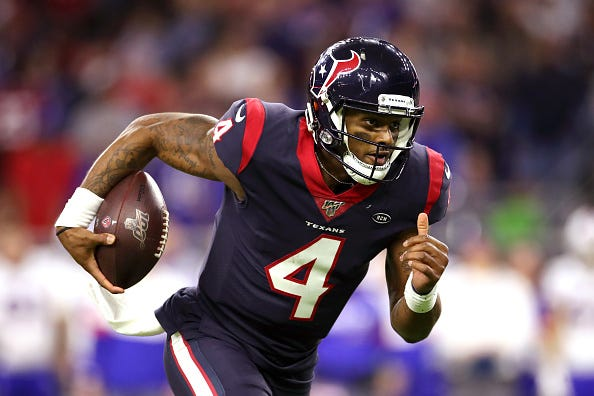 Deshaun Watson rushes with the ball for a Texans TD.