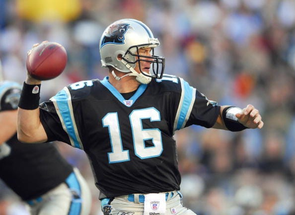 Chris Weinke throws a pass for the Panthers.