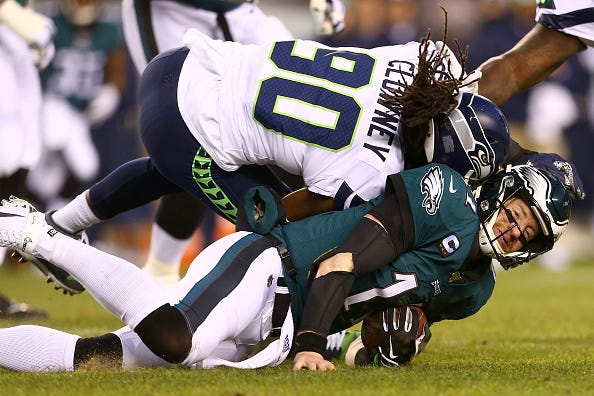 Eagles QB Carson Wentz takes a helmet-to-helmet hit.
