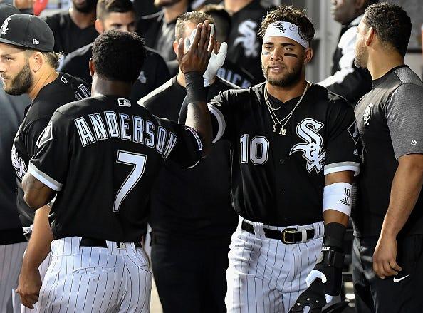 Yoan Moncada celebrates a home run with Tim Anderson