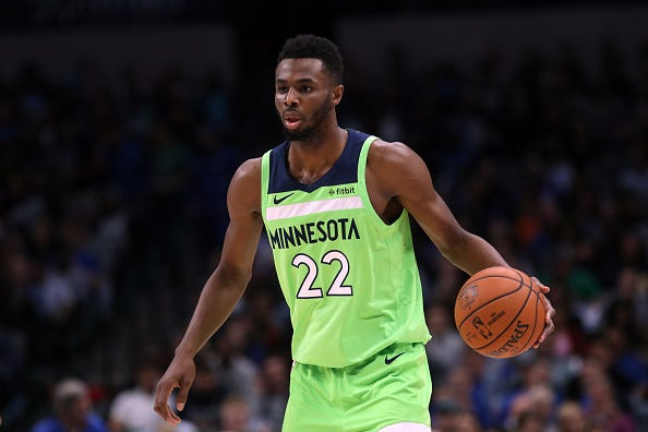 Andrew Wiggins dribbles the ball up court for the Timberwolves.