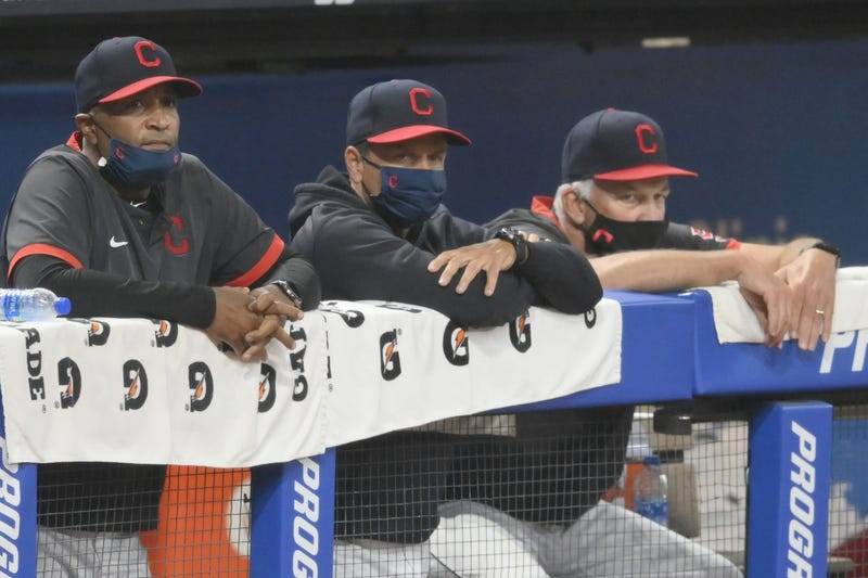 Cleveland Indians acting manager Sandy Alomar Jr, left, bench coach Mike Sarbaugh, center, and pitching coach Carl Willis watch from the dugout in the eighth inning against the Kansas City Royals at Progressive Field.