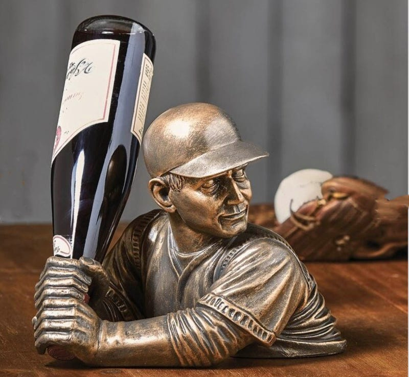 A baseball player wine holder.