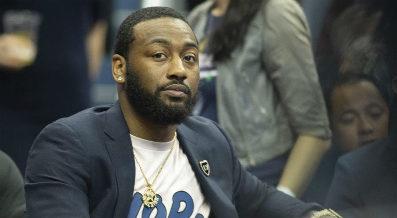 Wizards PG John Wall on the bench