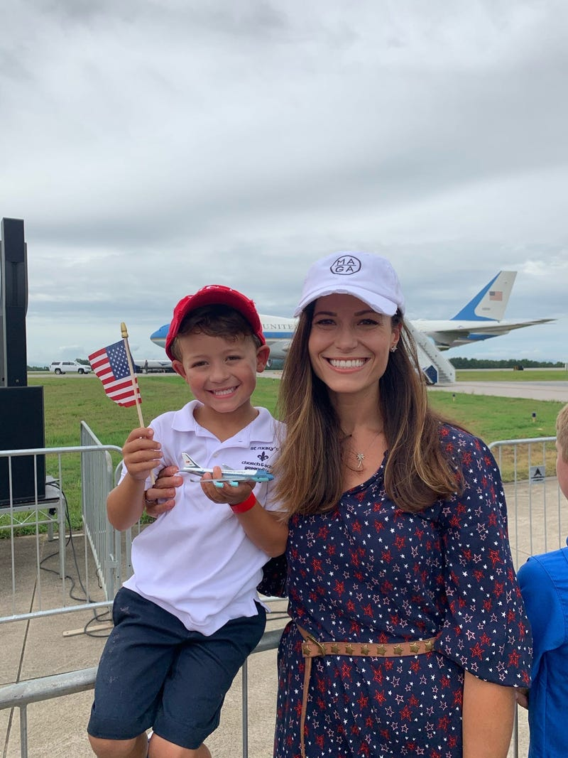 Woman and Child Await Trump at GSP