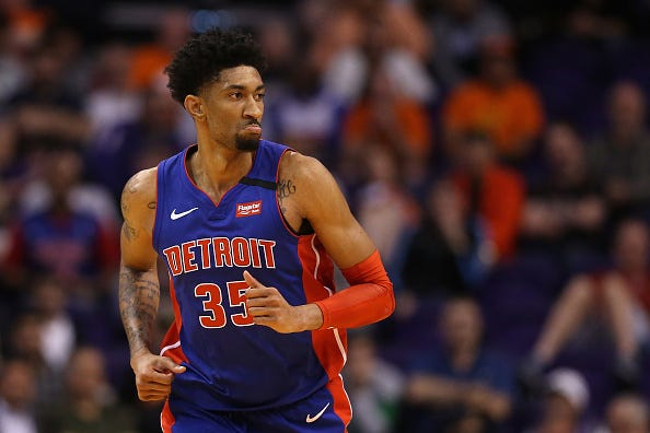 Christian Wood jogs down the court for the Pistons.
