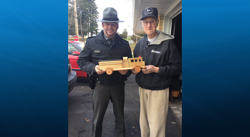 Ed Higinbotham donating his wooden toys to State Police