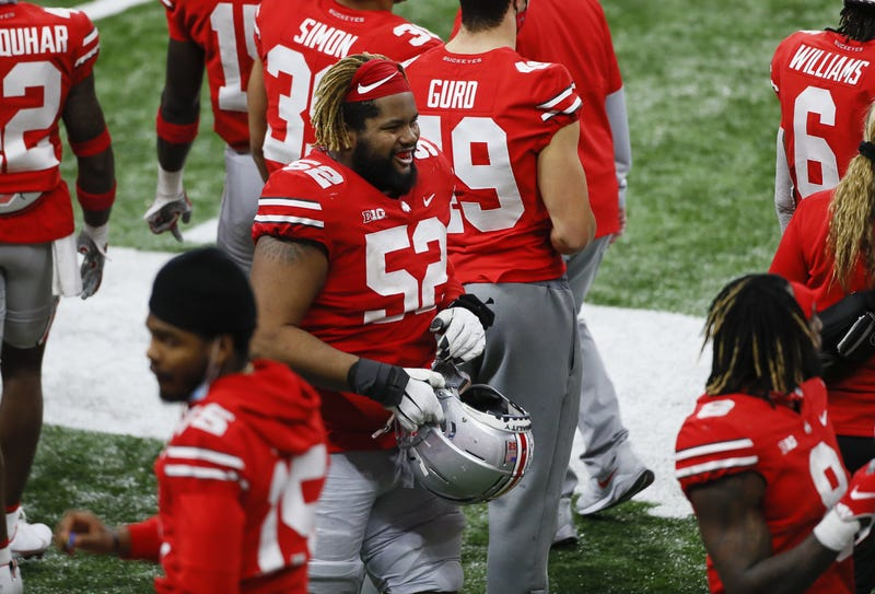 Ohio State OL Wyatt Davis joins his teammates on the sideline.