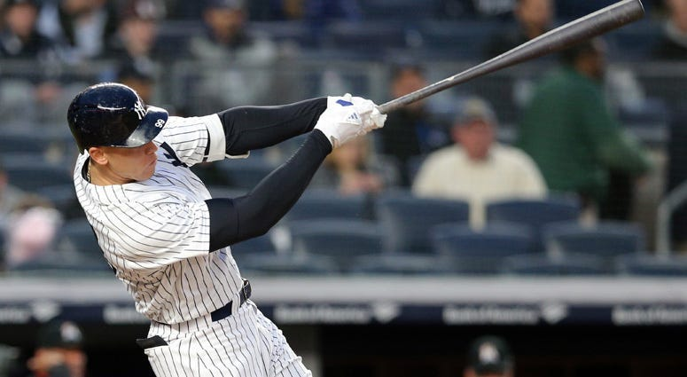 The Yankees' Aaron Judge follows through on a solo home run against the Miami Marlins on April 16, 2018, at Yankee Stadium.