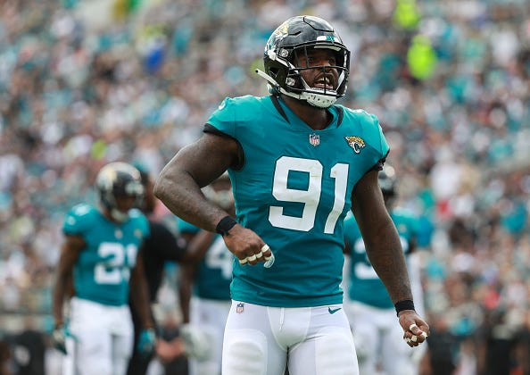 Jaguars DE Yannick Ngakoue celebrates a big play.