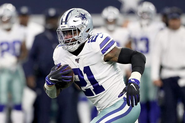 Ezekiel Elliott bursts down field in a game for the Cowboys.