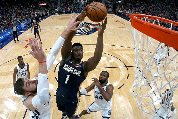 Zion Williamson rises to the hoop during a Pelicans game.