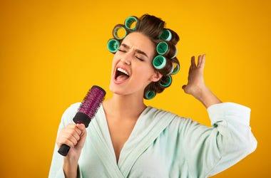 Singing into hairbrush